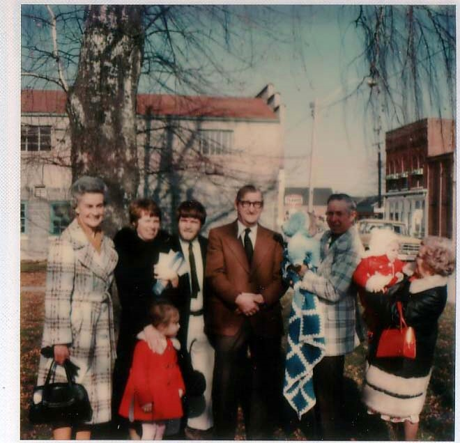 My Godfather 'Uncle Reg' centre, his beautiful 'Betty' far left.  Me in front.